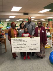 Marcellus Davis, a fourth-grader at Wetumpka Elementary School, received a $100 check from the Elmore County African-American Heritage Association for a winning essay.