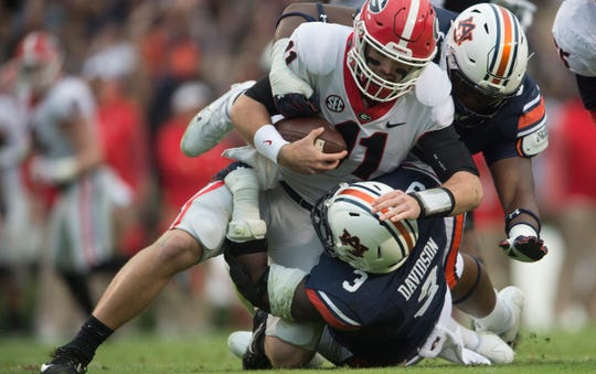 Auburn defensive linemen Marlon Davidson (3) and Derrick Brown (5) combine to sack Georgia quarterback Jake Fromm (11) on Saturday, Nov. 11, 2017.