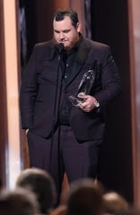 Luke Combs gets emotional as he accepts the Male Vocalist of the Year Award at the 53rd Annual CMA Awards at Bridgestone Arena Wednesday, Nov. 13, 2019 in Nashville, Tenn.