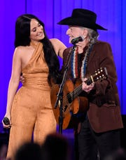 Kacey Musgraves and Willie Nelson perform at the 53rd annual CMA Awards at Bridgestone Arena on Wednesday, Nov. 13, 2019.