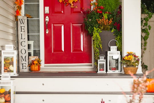 A seasonal wreath is a great way to dress up a front door. But if the door itself is tired, consider adding a fresh coat of paint in a cheery red or new hardware.