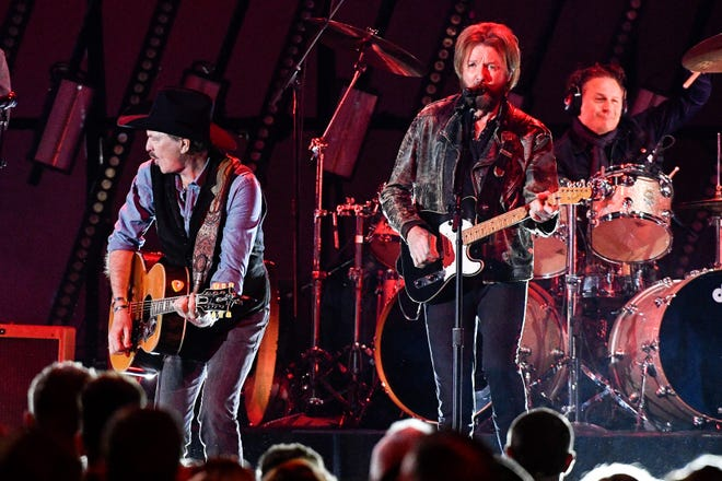 Brooks & Dunn – seen here performing with Brothers Osborne during the 53rd Annual CMA Awards at Bridgestone Arena in Nashville, Tenn., on Nov. 13, 2019 –  are co-headlining the Pepsi Gulf Coast Jam in Panama City.