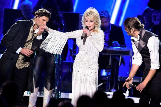 Dolly Parton performs with for KING & COUNTRY during the 53rd annual CMA Awards at Bridgestone Arena in Nashville on Wednesday, Nov. 13, 2019.