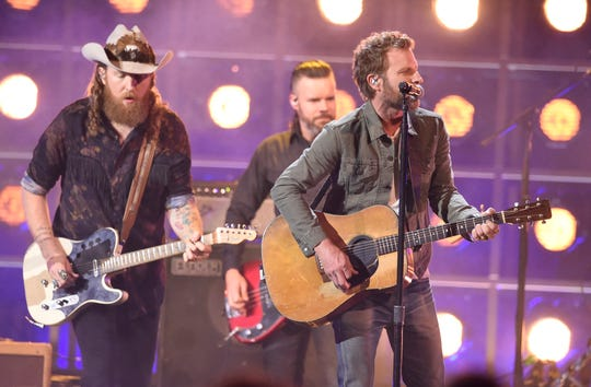 Dierks Bentley performs with Brothers Osborne at the 53rd Annual CMA Awards at Bridgestone Arena Wednesday, Nov. 13, 2019 in Nashville, Tenn.