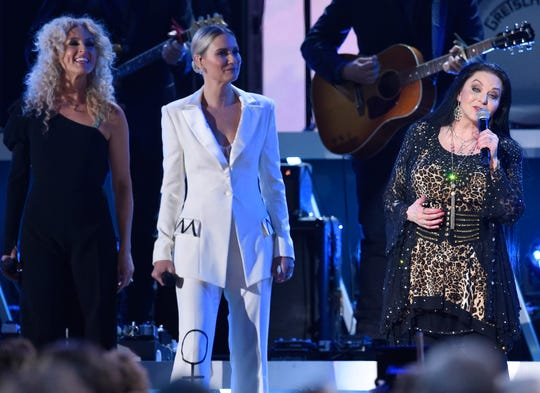 Kimberly Schlapman and Jennifer Nettles listen as Crystal Gayle sings at the 53rd Annual CMA Awards at Bridgestone Arena Wednesday, Nov. 13, 2019 in Nashville, Tenn.