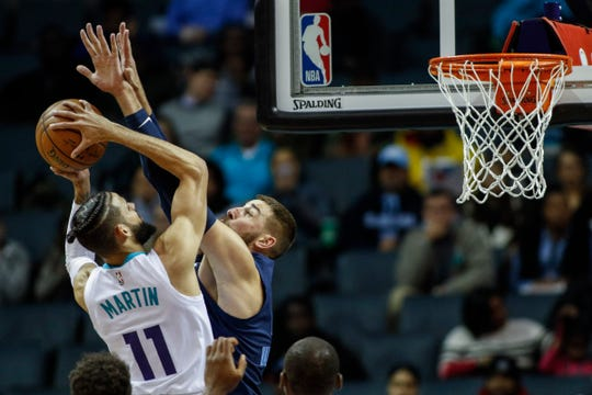 Charlotte Hornets forward Cody Martin (11) shoots against Memphis Grizzlies center Jonas Valanciunas in the first half of an NBA basketball game in Charlotte, N.C., Wednesday, Nov. 13, 2019.