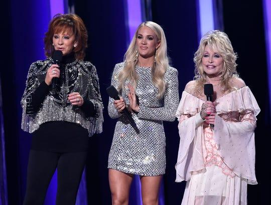 Hosts Reba McEntire, Carrie Underwood and Dolly Parton speak at the 53rd Annual CMA Awards at Bridgestone Arena Wednesday, Nov. 13, 2019 in Nashville, Tenn.