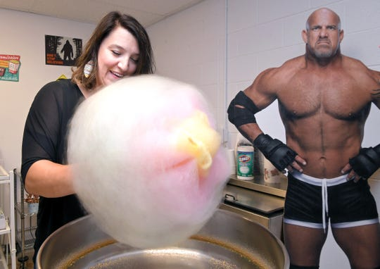 Stables Event Center owner and operator Lisa Marie Atkinson Blystad makes cotton candy near a cutout of WWE star Bill Goldberg in the concession stand on Sept. 6, 2019, in Cernterville, Tenn.