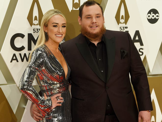 Luke Combs and Nicole Hocking on the red carpet at the CMA Awards in Nashville on Nov. 13, 2019. The couple was recently married.