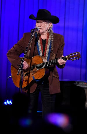 """Best Country Solo Performance: Willie Nelson - """"Ride Me Back Home"""" Here, Willie Nelson performs at the 53rd Annual CMA Awards at Bridgestone Arena Nov. 13, 2019 in Nashville, Tenn."""