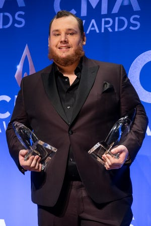 Luke Combs poses with his awards backstage in the press room during the 53rd Annual CMA Awards at Bridgestone Arena in Nashville, Tenn., Wednesday, Nov. 13, 2019.