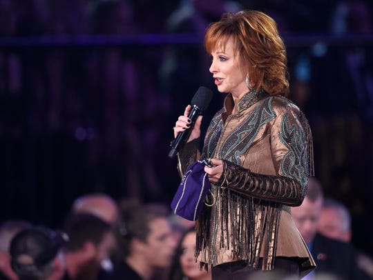 Host Reba McEntire speaks  about the Crown Royal Purple Bag Project at the 53rd Annual CMA Awards at Bridgestone Arena Wednesday, Nov. 13, 2019 in Nashville, Tenn.