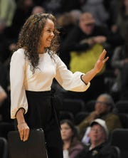 UConn assistant coach and former Vanderbilt player Jasmine Lister waves to the crowd during a game at Memorial Gym in Nashville on Wednesday, Nov. 13, 2019.