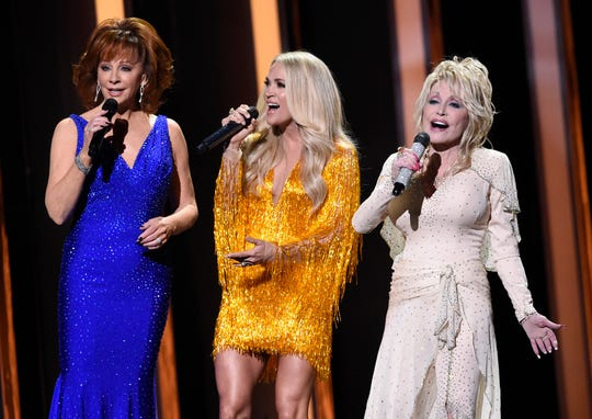 Hosts Reba McEntire, Carrie Underwood and Dolly Parton perform at the 53rd Annual CMA Awards at Bridgestone Arena Wednesday, Nov. 13, 2019 in Nashville, Tenn.