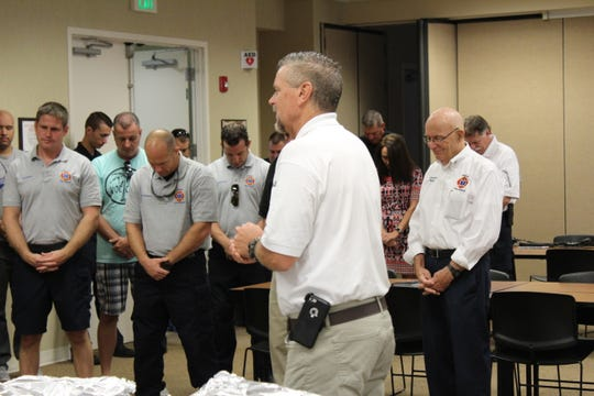 Mark Goodman prays at an Estero Fire Rescue event.