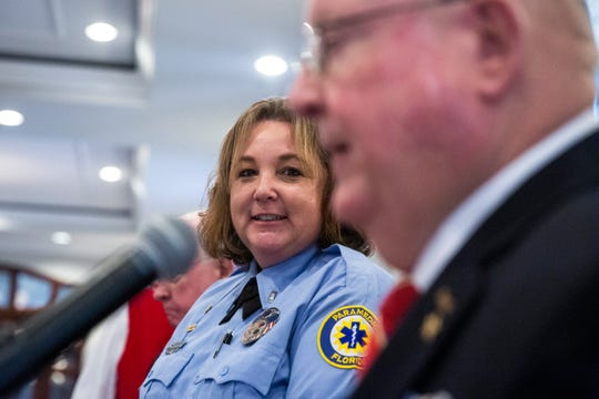 Company officer Jackie Lockerby for the Collier County Emergency Medical Services, left, watches Compatriot Acey Edgemon during the annual public service awards presentation on Thursday, November 14, 2019, at the Tiburón Golf Club in North Naples.