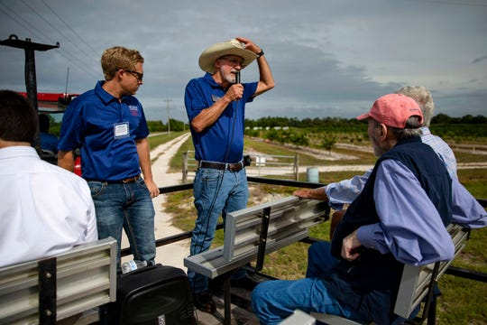 Southwest Florida Research and Education Center, SWFREC, Phillips Williams, left, and Gene McAvoy, an associate director for stake holder relations, speak during a tractor tour,Thursday, Nov. 14, 2019, during an open house event at Southwest Florida Research and Education Center in Immokalee.