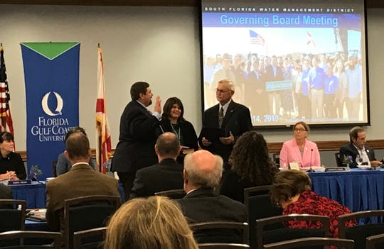 Benjamin Butler completes his oath of office as the newest board member of the South Florida Water Management District on Thursday, November 14, 2019, at Florida Gulf Coast University.