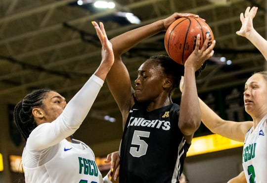 University of Central Florida's Masseny Kaba attempts to make a shot through Tytionia Adderly and Alyssa Blair's defense during a regular season game on Wednesday, November 13, 2019, at Florida Gulf Coast University.