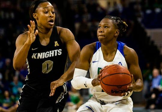 The Florida Gulf Coast University's Keri Jewett-Giles passes the ball through University of Central Florida's Sianni Martin's defense during a regular season game on Wednesday, November 13, 2019, at Florida Gulf Coast University.