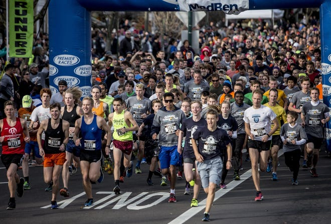 Runners cross the starting line during a past Granville Turkey Trot.