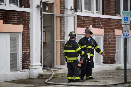 Passaic firefighters are seen working on a fire at 87 Henry Street in Passaic on 11/14/19.