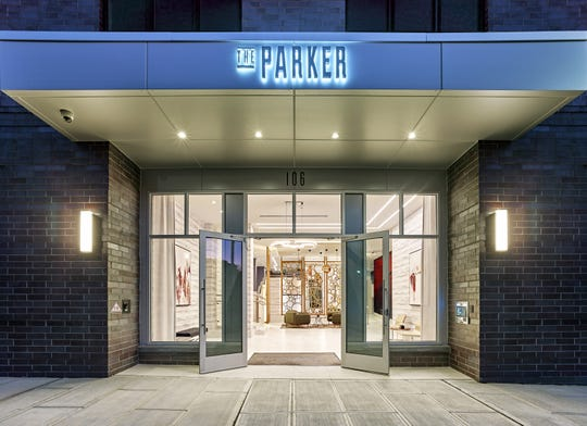 The inviting lobby of The Parker opens to Park Avenue in Rutherford,NJ, adjacent to dining and retail.
