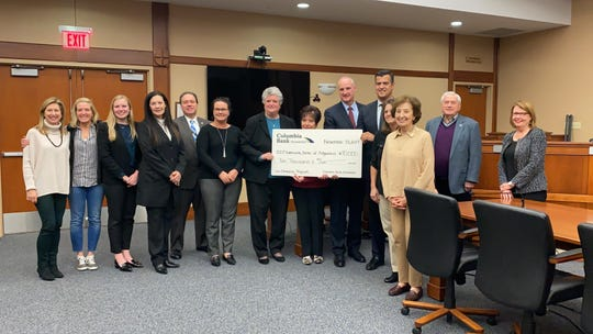 Columbia Bank officials and Ridgewood council members present a check to the Ridgewood Community Center Wednesday, Nov. 13.