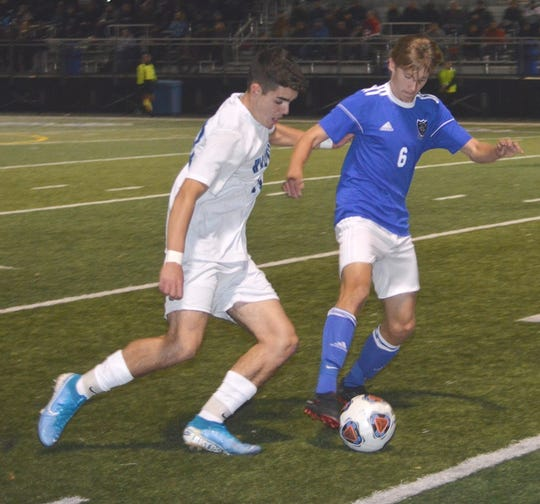 Wallington's Matt Tecza (6) taking on Waldwick's Kyle Carroll for the ball.