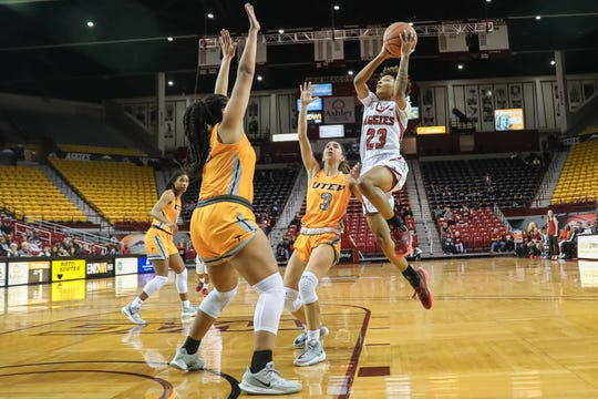 Junior guard Aaliyah Prince (23) shoots as the NMSU Aggies face off against the UTEP Miners at the Pan American Center in Las Cruces on Wednesday, Nov. 13, 2019.