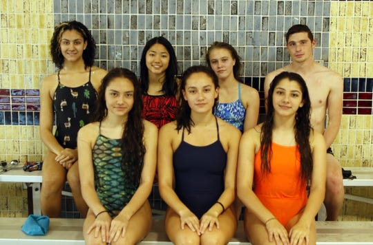 Back row left to right: Izabella Morgan, Zoe Char, Colette Dhenin and Tyler Plant. Front row left to right: Sophia Corder, Isabella Corder and Payton Jones pose on Nov. 13, 2019. All seven Carlsbad swimmers qualified for the state meet in their first meet of the season in Lubbock on Nov. 9, 2019.