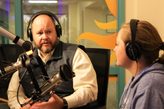 Farmington Mayor Nate Duckett, left, talks about his favorite music featured in movies with his daughter, Hannah Duckett, right, as they recorded a DJ for a Day radio program at the KSJE studio on the campus of San Juan College in Farmington on Nov. 12, 2019.