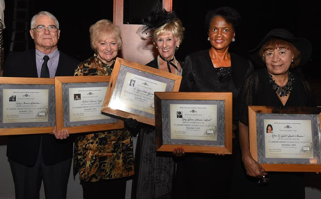 Women's Hall of Fame inductees, from left, are Mary Swords Debaillon, represented by her relative Dan Debaillon, Mavis Arnaud Fruge, Lynn Boles LeJeune, Mary Rideau Johnson-Doucet and Marie Magdalena Esprie Lemelle Simien, represented by her relative Etha Amling.