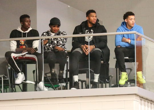 Milwaukee Bucks star Giannis Antetokounmpo, center right, watches the Wisconsin Herd game Wednesday night at Menominee Nation Arena in Oshkosh.