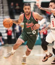 The Wisconsin Herd's Frank Mason III (15) drives past the Capital City Go-Go's Chris Chiozza during their basketball game Wednesday, November 13, 2019 in Oshkosh, Wis. The Herd won the game 123-113. Doug Raflik/USA TODAY NETWORK-Wisconsin
