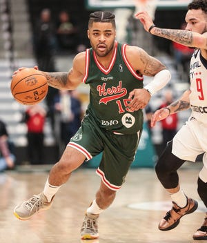 The Wisconsin Herd's Frank Mason III (15) drives past the Capital City Go-Go's Chris Chiozza during their G League game Nov. 13, 2019, in Oshkosh.
