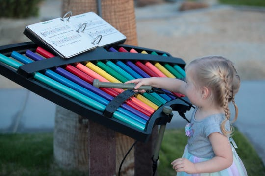 A girl plays at the Children's Discovery Museum's Music Garden dedication on Wednesday, November 13, 2019 in Rancho Mirage, Calif.