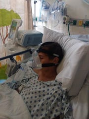 Zane Martin, 15, of Desert Hot Springs, experienced a vaping-related lung illness. Here, he is hooked up to a breathing machine at Loma Linda medical center.