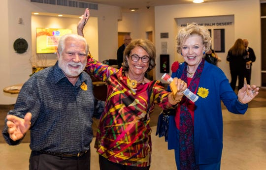 Bill Sullivan, Jane Saltonstall and Patty Newman show off their moves.