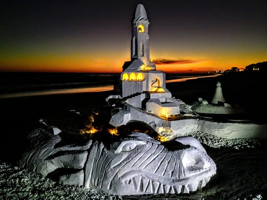 A sandcastle made by sand sculptor Dan Anderson of Miramar Beach in October is illuminated with a series of LED lights.