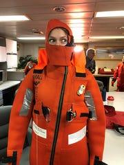 University of West Florida graduate student Leila Harris tries on a survival suit.