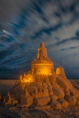 One of Dan Anderson's illuminated sandcastle creations stands in Destin.