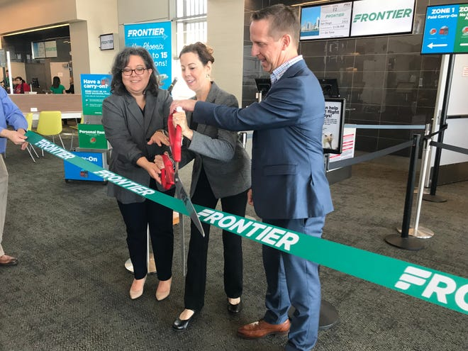 Kiva Couchon, Arizona Office of Tourism, Deborah Ostreicher, Asst. Director of Aviation for Sky Harbor and Josh Flyr, Vice President of Network and Revenue for Frontier, cut a ribbon launching the first Frontier flight from Phoenix to San Diego.