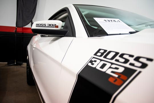 "A 2013 Ford Mustang Boss 302S Race Car sits parked at a sneak preview of the late ""Fast and Furious"" star Paul Walker's car collection at Barrett-Jackson in Scottsdale on Thursday, Nov. 14, 2019. The 21-car collection will be auctioned off at Barrett-Jackson in January 2020."