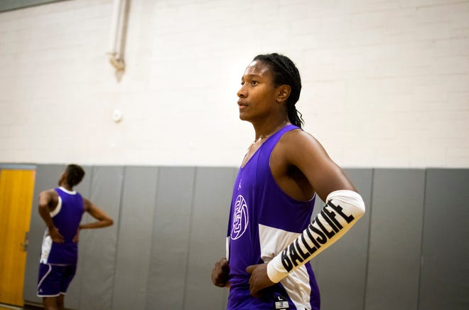 Caesar Chavez guard TyTy Washington rests between drills during basketball practice at Caesar Chavez High School in Laveen on Nov. 6, 2019.