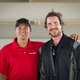 "Christian Bale (right) poses with Bondurant High Performance Driving School instructor Rob Knipe in fall 2019 while training for his role as race car driver Ken Miles in ""Ford v Ferrari."""