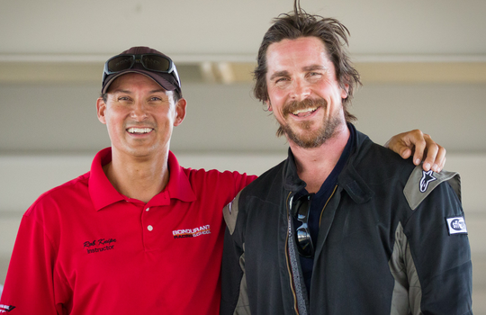 """Christian Bale (right) poses with Bondurant High Performance Driving School instructor Rob Knipe in fall 2019 while training for his role as race car driver Ken Miles in """"Ford v Ferrari."""""""