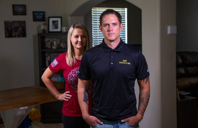 Alicia Rozell and her husband, Roman Rozell, pose at home in San Tan Valley. Roman is a former Green Beret who now is on the wrestling team at Arizona State University. The 35-year-old survived gun battles, roadside bombs and electrocution in Afghanistan. But, he says that nothing was scarier than drug addiction and poverty growing up in Apache Junction.