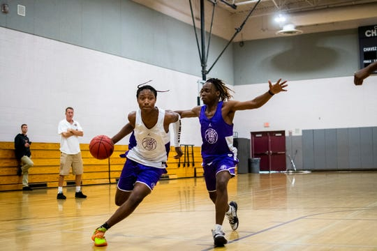 Caesar Chavez guard TyTy Washington dribbles toward the basket while Ashton Owens defends during basketball practice at Caesar Chavez High School in Laveen on Nov. 6, 2019.
