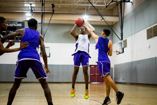 Caesar Chavez guard TyTy Washington shoots the ball as Ricardo Sarmiento attempts to block him during basketball practice at Caesar Chavez High School in Laveen on Nov. 6, 2019.